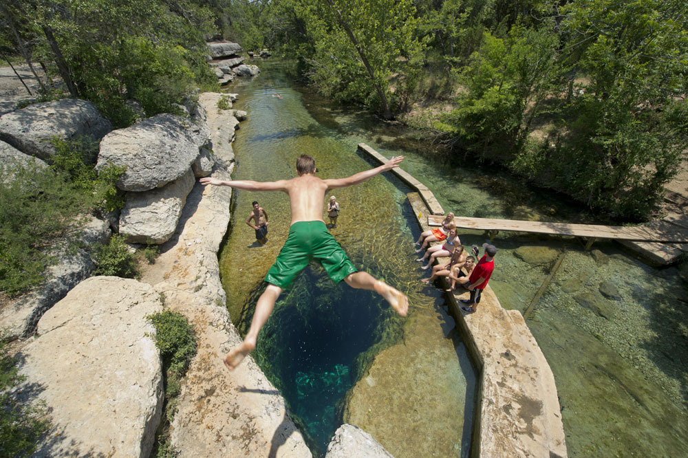 Karst springs make iconic swimming holes (Jacobs Well).